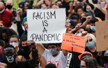 This image has an empty alt attribute; its file name is protest-signs-racism-is-a-pandemic-360x225-2.jpg